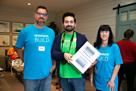 Emilygrene employees present a Sonos Play to a Habitat homeowner.